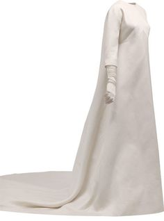 Wedding dress in ivory gazar | Cristóbal Balenciaga (Spanish, 1895-1972) | Spain, 1968 | Long dress with a rounded train. The front is made from a single panel, which extends to form the back of the dress. It has an inverted 'V' seam under the bust and darts. The neckline is round and the kimono sleeves are made by extending the yoke | Museo Cristóbal Balenciaga, Getaria, Spain