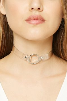 A clear vinyl choker featuring a high-polish buckled ring pendant and an adjustable belted back closure.
