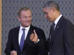 President Barack Obama (R) gives a thumbs-up as he arrives with Polish Prime Minister Donald Tusk to speak to the press following a meeting in Warsaw, Poland, on June 3, 2014. Obama arrived for a two-day Polish visit, the first stop on a European trip, and will discuss