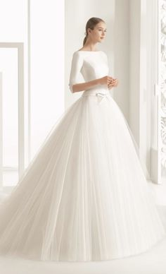 Classic silk quarter length sleeve wedding dress with tulle ballgown skirt; Featured Dress: Rosa Clará