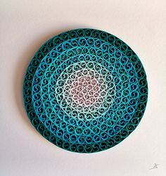 """""""Ripple Effect"""" quilled/card filigree picture framed using strips of card by Debbie Brannen."""