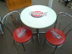 $165 - Sold as a 3 piece set. This is a chrome base table with two chrome chairs. Chairs have red seats with coca cola over a bottle cap. The same trademark is centered on the white table top. The table measures approximately 30 inches in diameter.  It can be seen in booth C 17 at Main Street Antique Mall 7260 East Main St ( E of Power Rd ) Mesa 85207  480 9241122 open 7 days 10 till 530 Cash or charge 30 day layaway also available
