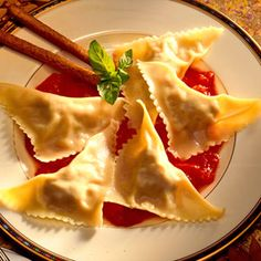 Purchased wonton wrappers stand in for pasta in this homemade ground chicken ravioli recipe for two.