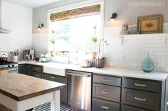 kitchen with grey cabinets and subway tile - No upper cabinets and drawers for dishes instead...