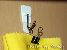 Hang rubber gloves inside kitchen cupboard using a Command Hook & binder clip.