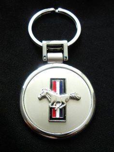 Mustang Brushed Chrome & Silver Keyring by Ronzelli Creations. $17.00. Mustang Brushed Chrome & Nickel Silver Keyring.  Carry your keys in absolute luxury with this sleek and modern key ring featuring a brushed silver center and a chrome silver border for a graphic effect. This unique keyring sports the ford mustang logo in center of keyring. Give your Mustang keys a special home with this unique keyring. Signature gift box included, Made in USA.