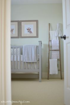 Take a peek inside of this sweet and tranquil gender neutral nursery. A traditional grey crib, polka dot bedding and a subtle safari theme make this the perfect nursery for any baby girl or baby boy to grow into | A Burst of Beautiful