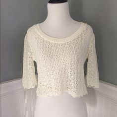 Cute cropped sweater With 3/4 sleeves. It is see through but looks cute layered with a tank underneath or dress. There is no brand or tag but there is a cute bow where the tag should be lol Sweaters Crew & Scoop Necks