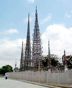 "Simon Rodia- The Watts Towers, Towers of Simon Rodia, or Nuestro Pueblo (""our town"") are a collection of 17 interconnected sculptural structures within the Simon Rodia State Historic Park in the Watts community of Los Angeles. The tallest of the towers reaches a height of over 99 feet (30 m). The towers and walls were designed and built by Sabato (""Simon"") Rodia (1879-1965), an Italian immigrant construction worker and tile mason, over a period of 33 years, from 1921 to 1954."