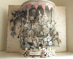 Alice in wonderland altered book A Mad Tea Party  repurposed recycled 1943 book designed like a Gazebo tea time 10x7x3 approximate comes with