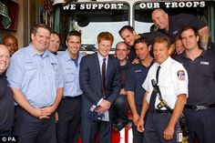 Prince Harry meets firefighters from Engine 10-10 in Lower Manhattan who lost colleagues in the 9/11 attacks.  The crew presented Harry with a fireman's T-shirt and helmet.  (2009)