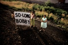 Taken from the Robert F. Kennedy funeral train, 1968.  © Paul Fusco / Magnum Photos