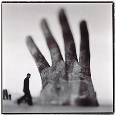 Keith Carter  --> he got to photograph my favorite Giant Sculpture before it was moved and ruined forever!