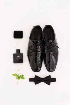 Groom accessories perfectly displayed for a wedding day detail shot