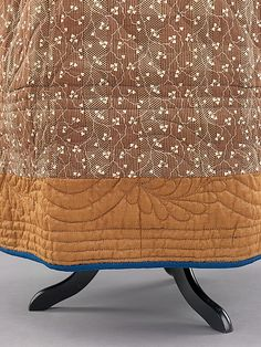 An inside view of the blue quilted petticoat. 1840-1850