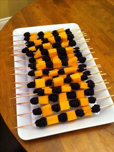 """Happy & Healthy Halloween Treats""  Couldn't find a source page - ""fruit and cheese skewers"" Google image search yields tons o' ideas"
