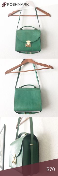 Furla Green Leather Bag Be green with envy for this stunning vintage furla purse. Features leather, front clasp, top handle and removable strap. In fantastic shape with minor blemishes as shown. Feel free to make an offer 💕 Furla Bags