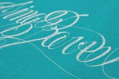 Beautiful handwriting screenprinted on turquoise paper