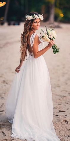 In general, the choice of beach wedding dresses is endless. Such a romantic type wedding is much deserving of a simple sexy wedding dress. dresses for wedding guest beach destinations 51 Beach Wedding Dresses Perfect For Destination Weddings Simple Sexy Wedding Dresses, White Beach Wedding Dresses, Outdoor Wedding Dress, Boho Wedding Dress, Wedding Beach, Wedding Summer, Summer Beach Weddings, Simple Beach Wedding Dresses, Hawaiin Wedding