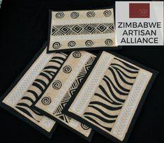 """White Yellow Black Animal Print Placemats"" Zimbabwe Textiles Setof4 hand printed Africanplacemats.  TheseplacematsarehandprintedbyZimbabweanwomenwhoworkfrom home. TheirwaresarethensoldattheAvondaleMarketinHarare, Zimbabwe.  This set was made by the artist Patricia."