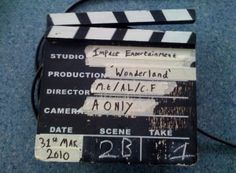 A_Traditional_Wooden_Slate_Clapperboard-300x220