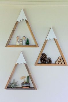 15 Decor Ideas For Creating A Woodland Nursery Design | These mountain shelves are a fun way to put a twist on a regular triangle shelf and create the perfect modern woodland shelving solution.