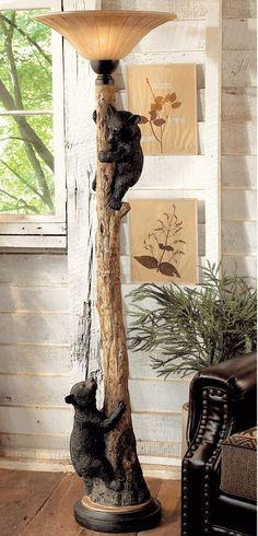 Climbing Bears Floor Lamp This would sooo work in my house, but not for $700!!