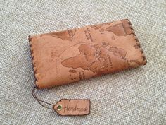 Leather Tobacco Pouch in natural color. The pyrography displays the map of the world. It has internal pockets for papers and filters. The item is 100% handmade.   Dimensions: 150mm x 200mm.
