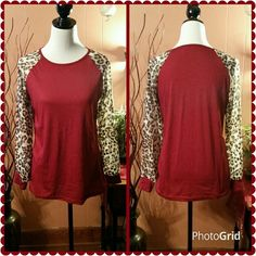 Red top with cheetah print sleeves. Beautiful beet red color top. Sheer cheetah print sleeves. 20 inches from armpit to armpit.  26 inches from shoulder to hem.  New with tag. Boutique  Tops