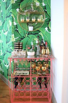Apartment Reveal: The Bar Is Open & Theres Never a Last Call! KERRently by Home Deco Apartment Bar bold print wallpaper bedroom Call KERRently open Reveal Diy Bar Cart, Gold Bar Cart, Bar Cart Styling, Bar Cart Decor, Bar Carts, Tropical Kitchen, Tropical Home Decor, Pink Bar, Outside Bars