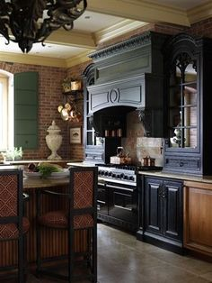 French Country Kitchen by designers Sally Wilson and John Kelsey of Wilson Kelsey Design, brick walls, black painted cabinets, old worls, shutters, antique. I  want this!!!!!