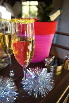 DIY Holiday champagne using edible gold glitter stars as glass rimmer.