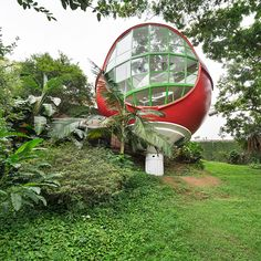 A spherical dome house in Sao Paolo, Brazil, with designer interiors and tropical views.