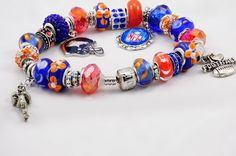 """Denver Broncos"".  A European charm bracelet created for Denver Broncos fans.  Blues, Oranges and official NFL team icons."