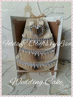 Check out this item in my Etsy shop https://www.etsy.com/uk/listing/527778662/stunning-ivory-and-gold-wedding-cake
