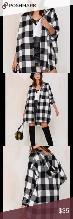 #272 Camp Out Flannel Get a head start on fall with this cozy essential. The Camp Out Jacket is made in a black and white checkerboard flannel and features an oversized fit, snap-front closure, snaps at cuffs, side pockets, and hood. Wear it with anything from ripped skinnies and a vintage tee to a bodycon dress and heels.  *Polyester  *Runs true to size  *Model is wearing size small  *Hand wash  *Imported Nasty Gal Tops Button Down Shirts