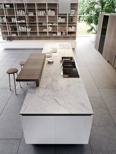 A minimalist dream: Polished Way Materia Kitchen for the urban home Marble kitchen island countertop along with wooden breakfast bar, Kitchen Bar Design, Luxury Kitchen Design, Luxury Kitchens, Interior Design Kitchen, Refacing Kitchen Cabinets, Kitchen Cabinetry, Kitchen Wood, Kitchen Modular, Building A Kitchen