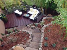 Bamboo Backyard Backyard Garden Patio Design Ideas With Stone And Chair Home Backyard Backyard Garden Design Ideas With Patio Garden Landscaping Ideas - Grezu : Home Interior Decoration Steep Backyard, Backyard Fences, Backyard Ideas, Landscaping Ideas, Patio Ideas, Sloped Backyard, Tropical Backyard, Mulch Landscaping, Rustic Backyard