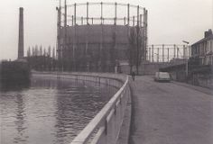 Riverside, Cambridge, The gas holders are gone but, beyond them, the old sewage pumping station and its chimney remain as a museum. See Prisoner photo of the scene more recently Honeymoon Night, Cambridge Uk, Old Photos, Past, Nostalgia, England, Scene, World, Places