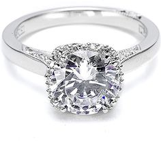 Tacori Engagement Ring w/ Pave Set Diamonds  : This stunning handmade Tacori engagement ring # 2620 features round brilliant pave-set diamonds around the center diamond as well as partially on the band.