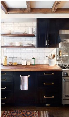 The cabinet color is too dark but I like the butcher block, the gold hardware and the backsplash.