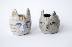 Ceramic cat head cups / planters. Made by Kaye Blegvad.