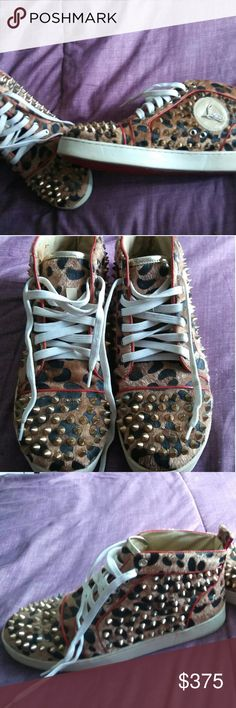 Womens Christian Louboutin sneakers Very stylish Good used condition. Got plenty of compliments the very few times I did wear them. Some spikes missing not very noticing. No box no bag. These are a reposh the seller guarantees that these are authentic however I myself do not have paperwork to prove they are.  Happy Poshing! Christian Louboutin Shoes
