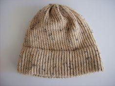 Loom knit hat with one strand of Red Heart yarn on the Boye light weight round loom for adult sized hats.