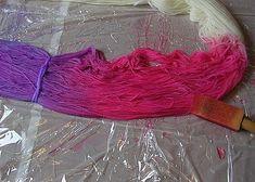 Painting dye onto the yarn.