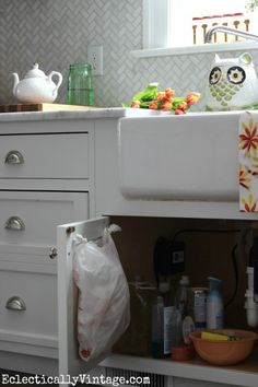 Get those plastic bags organized under the kitchen sink eclecticallyvintage.com #DamageFreeDIY