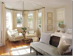 I prefer to handle bay windows like this – with a panel between each window. It makes for less of a large expanse of windows, especially when the trim is painted a different color than the walls.