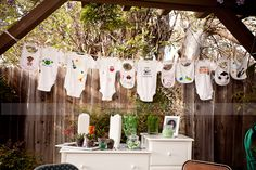 Clothes line onsies & bibs dresser for candy buffet #babyboy #babyshower #onsies #candybuffet http://ginamariestudios.com/
