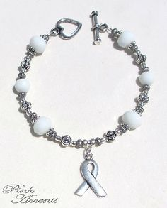 Osteoporosis Awareness: White Glass and Sterling Silver Plated Bracelet, 8.25 inches.  30% of your purchase price goes directly to the Foundation for Osteoporosis Research and Education!  FORE conducts community-based research to help improve the quality of care and management of osteoporosis and information to professional health care providers.