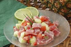 Recipe for poisson cru, raw fish marinated in lime juice and coconut milk, the national dish of Tahiti.